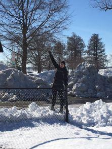 Standing tall on a snowbank.